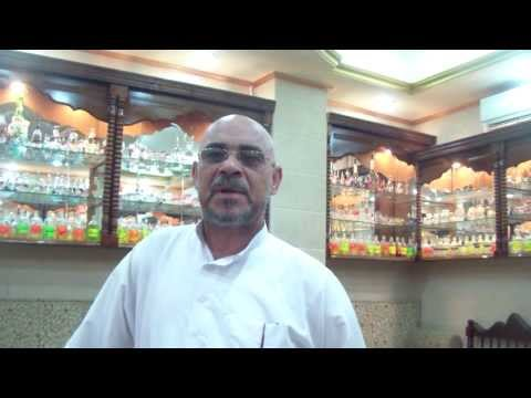 Egyptian fragrance merchant discussing tourism in Egypt