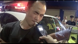 Hilarious Video: Drunk Driver Fails to Fool Breathalyzer in south China City