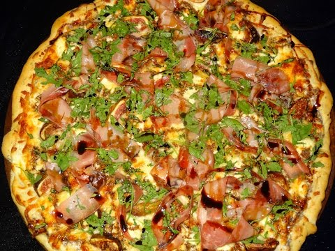 Fig, Goat Cheese, Prosciutto Pizza Garnished with Balsamic Reduction and Arugula