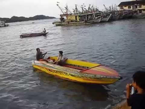 Boats, fish, and smokers at Kota Kinabalu - Borneo Island