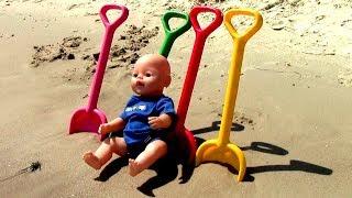 Mania plays with toys on the beach