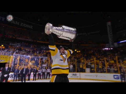 Penguins take their turns hoisting the Stanley Cup