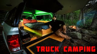 Truck Camping In Rąin With Campfire And Tarp Shelter