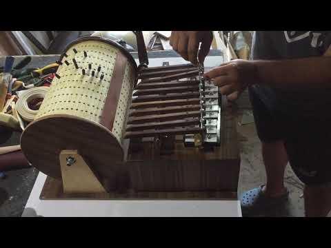 Wooden mechanical music box