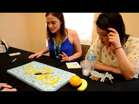 Ingrid Nilson and Alexandra Carter Maud Pie And Peppermint Twist signing the Fillycon sign.