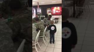 5 year old shows respect to members of the military.