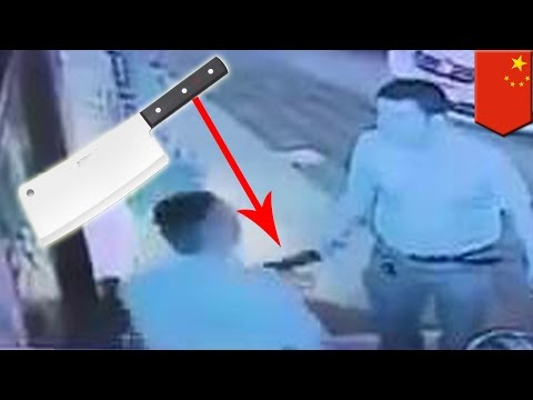 Meat cleaver-wielding Chinese man rages after karaoke bar fight in Shanghai (VIDEO)