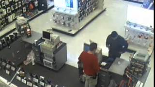 A man police suspect of stealing credit cards from a customer at the Cheesecake Factory is shown making a purchase at Target on Reynolds Road.