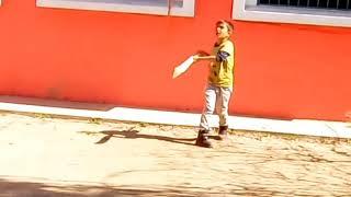 Saalaar in action. Small kid playing cricket