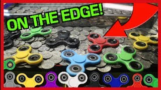 WINNING FIDGET SPINNERS FROM A COIN PUSHER!!! | Arcade Games