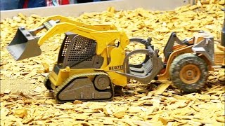 Kids test Carson Hobbyline rc wheel loaders and compact track loader