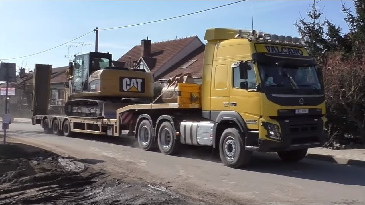 Volvo FMX 500 and Cat excavator - YouTube