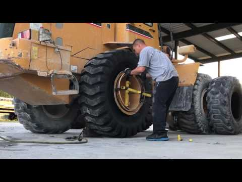 Changing 2 loader tires 20.5-25
