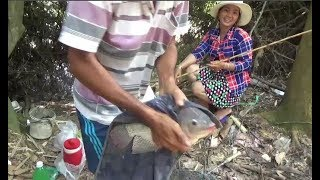 Stream fishing - the couple fight with tilapia