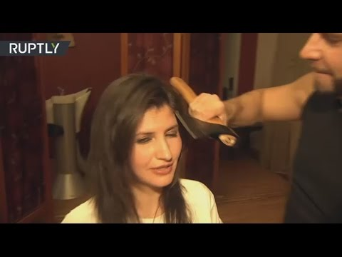 Within hair's breadth: Russian stylist changes scissors for axe to make cool haircuts