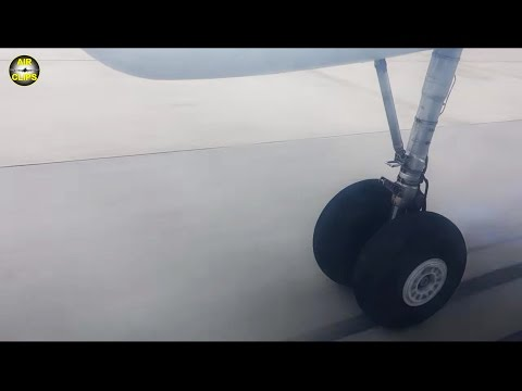 Gear Cam! Watch An Antonov 26's main gear during Touch & Go on rugged runway!!! [AirClips]