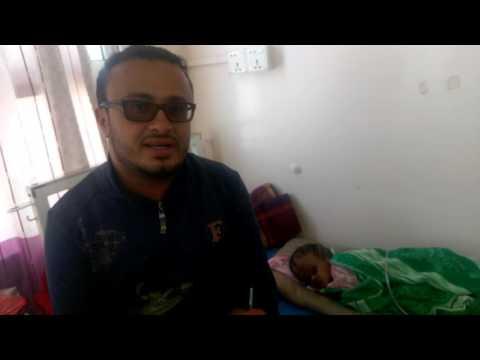 Ahmad Algohbary with poorly baby Mohammad in Yemen