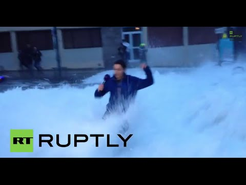 France: See huge WAVE sweep reporter off her feet during LIVE broadcast