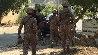 Suspected suicide bombers who attacked Chinese consulate in Pakistan's Karachi were killed