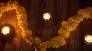 Top view of the decorated floor with burning Diyas and marigold garlands for Diwali festival