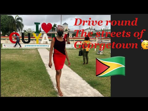 DRIVING THROUGH THE STREETS AND HOUSES IN GEORGETOWN GUYANA | Seawall Vlog part 1