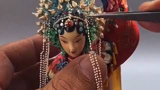 Check out how a Chinese artist dressed up his self-made dough figurine.