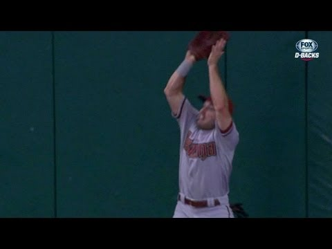 Eaton makes a tough leap on a fly ball
