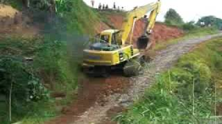 komatsu heavy equipment working in the village