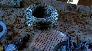 Unboxing and installation Strata heavy duty clothesline kit .