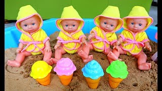 Baby Dolls Playing in the Sand