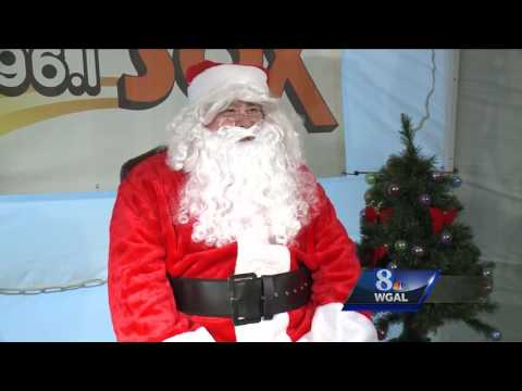 Santa D collects toys at Columbia, Wrightsville bridge