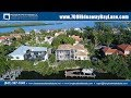A sunny walk to secluded Gulf of Mexico beach, Longboat Key home for sale
