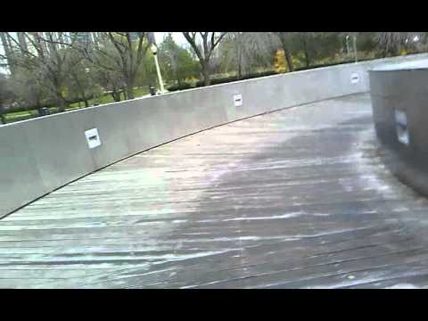 sliding down the bp bridge in millennium park