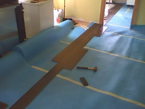 How to install laminate flooring without room transitions - YouTube