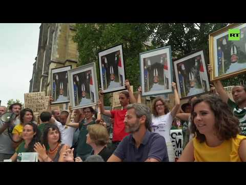 Demonstrators gather to protest Macron near G7 summit