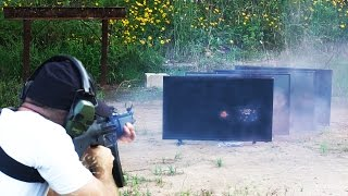How Many 4K TVs Can a Full Auto MP5 Machine Gun Shoot Through? Bonus: M79 Grenade Launcher Test