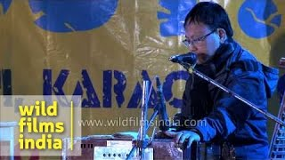 Sikkimese classical artist performs with harmonium during Winter Carnival