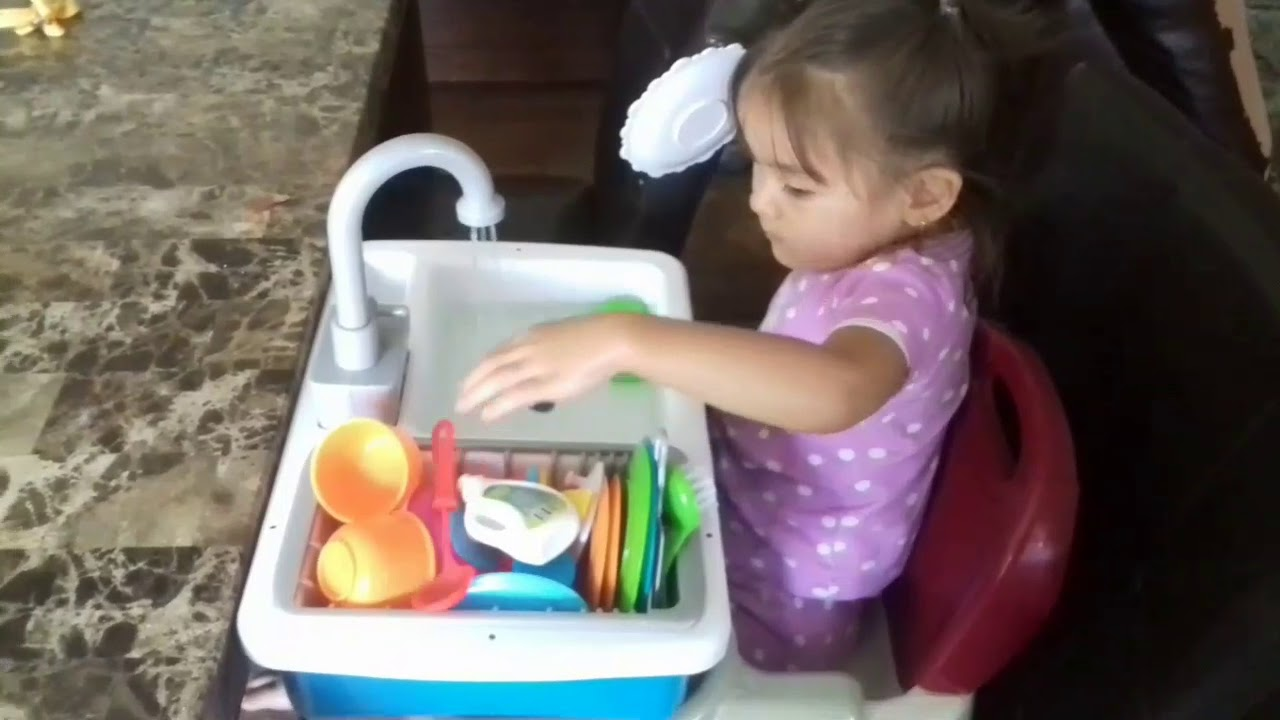 Baby Playing With Wash-Up Kitchen Set Toy With Real Water Working ...