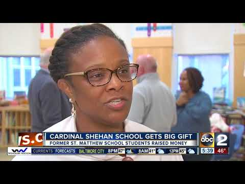 Former students give $7,000 to Cardinal Shehan School