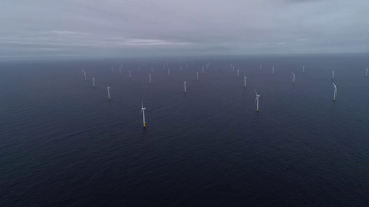 Drone shot of Vestas gybing, wind farm, close up of a windmill.