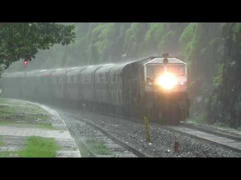 Train In Rain : A Spectacular View Of 16346 TVC-LTT Netravati Express Skipping Ukshi In Heavy Rain.