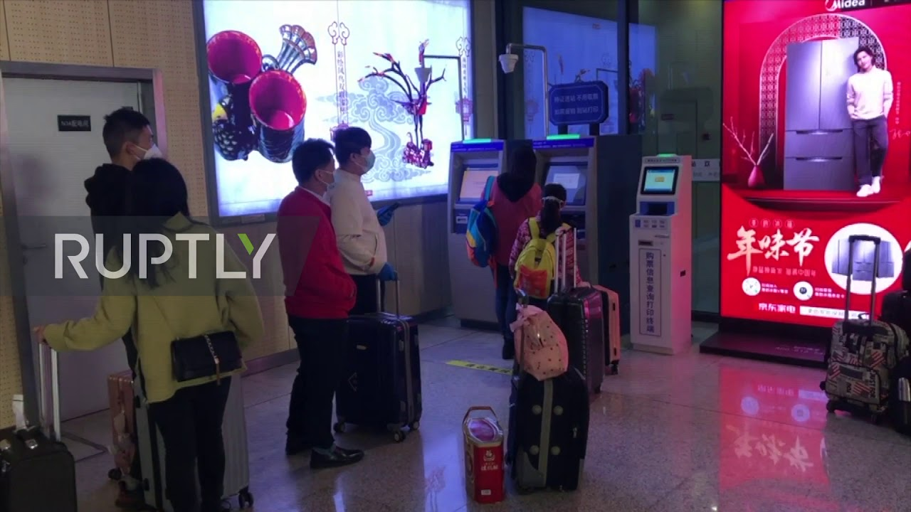 China: Passengers flock to Wuhan train station as lockdown is lifted