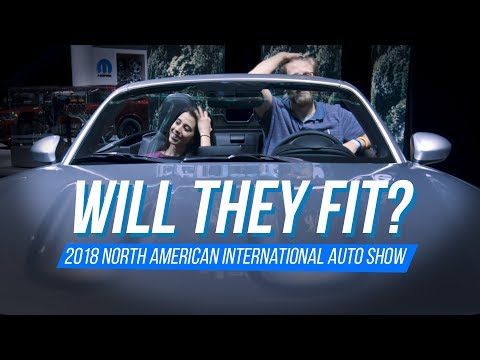 Will They Fit? Differently sized reporters squeeze and hop into cars at 2018 NAIAS