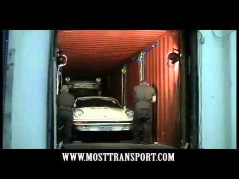 Загрузка  контейнера автомобилями