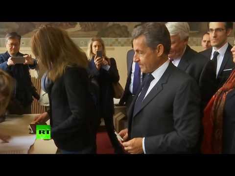 Николя Саркози и Карла Бруни проголосовали на выборах президента Франции