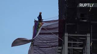 LIVE: Extinction Rebellion protester climbs up scaffolding on Big Ben.