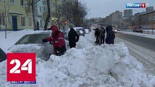 Месячная норма снега и разбитые машины: непогодой затянуло запад и восток России - Россия 24