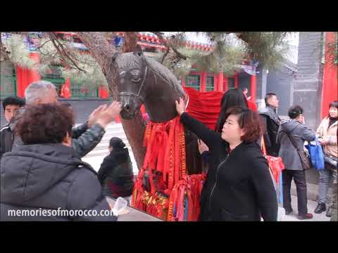 Chinese people rubbing a magic horse for good luck and money, Shenyang temple, China