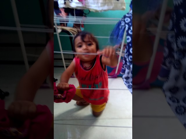Chinmay - Playing near cloth drying stand