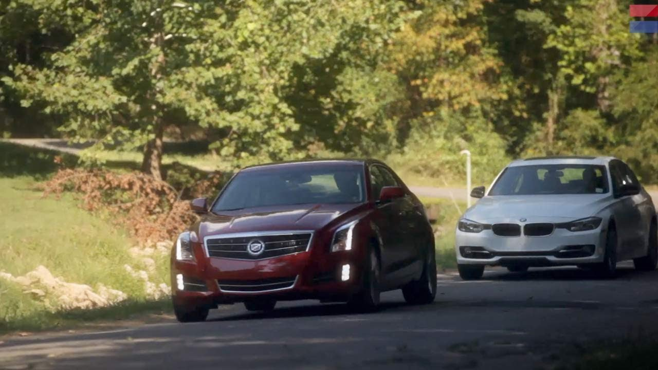 Showdown 2013 Cadillac Ats 2 0t Vs 2013 Bmw 328i Car And Driver